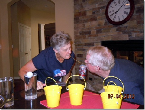 Ginny and Joe sucessfully carried the soda can to the table.
