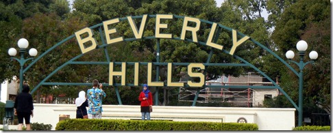 Beverly Hills sign on Santa Monica BLVD .
