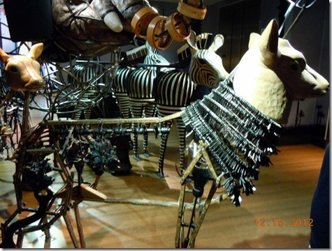 A deer made from keys, a carborator and rulers.