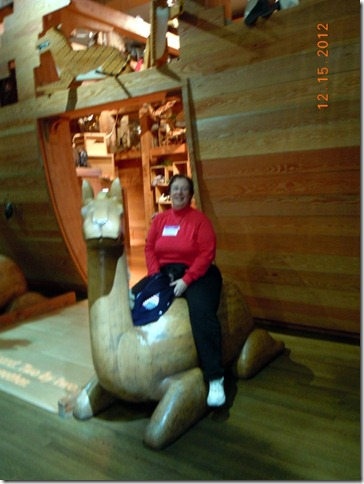 Denise riding a camel.