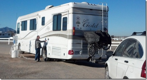 Bob filling the motor home with water at Roses in Quartzsite
