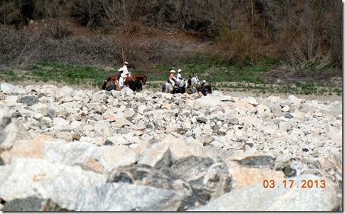 Horseback riders, below the dam.