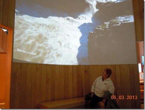 Margie watching a water movie exhibit