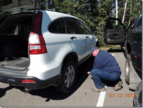 Bob changing tire-Denali Park Tour
