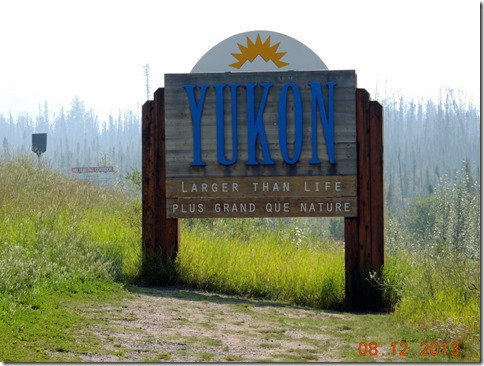 Welcom to Yukon sign with forest fire smoke in background