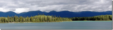 Boya Lake from campsite with new snow on mts.