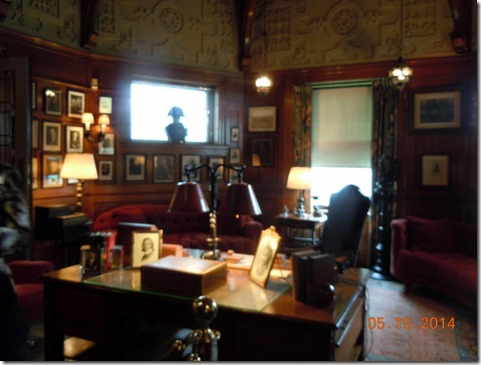 Olivers office, with presidential pictures on the wall.