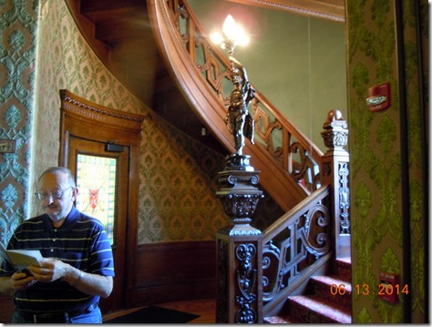 Circular stairway in the Grand Foyer with curved door and stain glass.