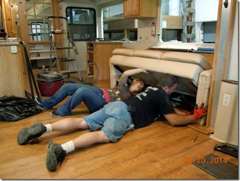 PJ and Megan installing the sofa
