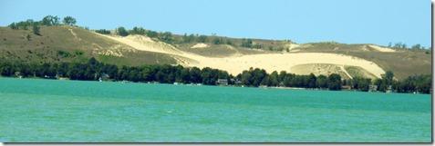 Bear Lake with Sleeping Bear Dunes behind the lake.