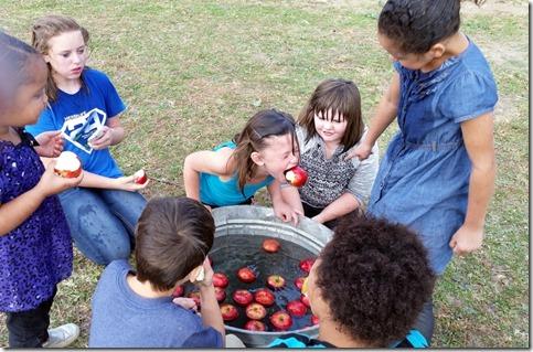 Neice Rori bobbing for apples