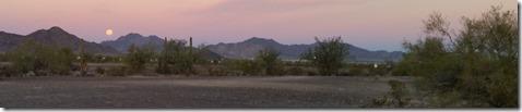 Moon setting over the desert