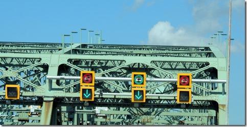 Sing on bridge entering Montreal