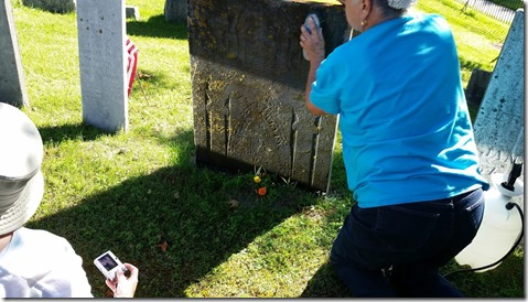 Connie cleaning headstone, At the Cemetery with the SKP Genies